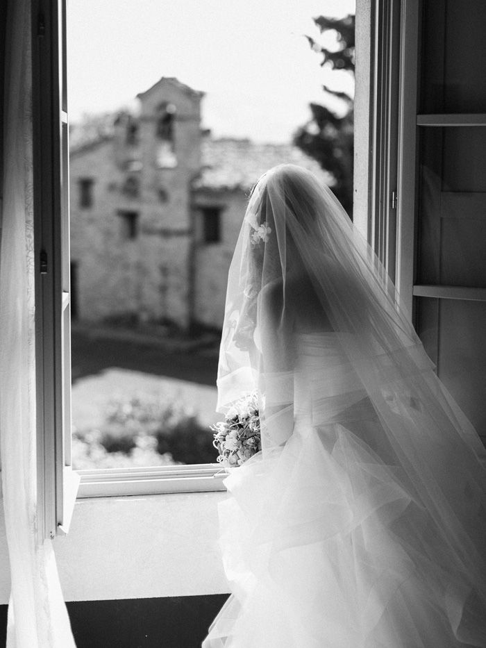 italian bride looking out window