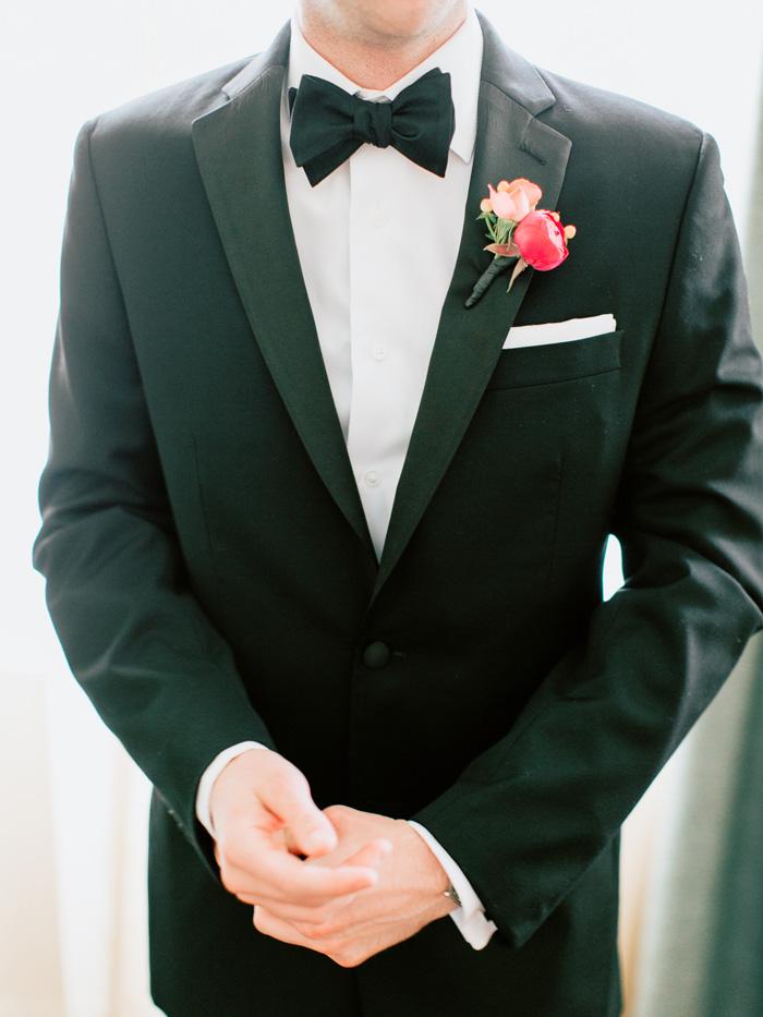groom bow tie and tuxedo