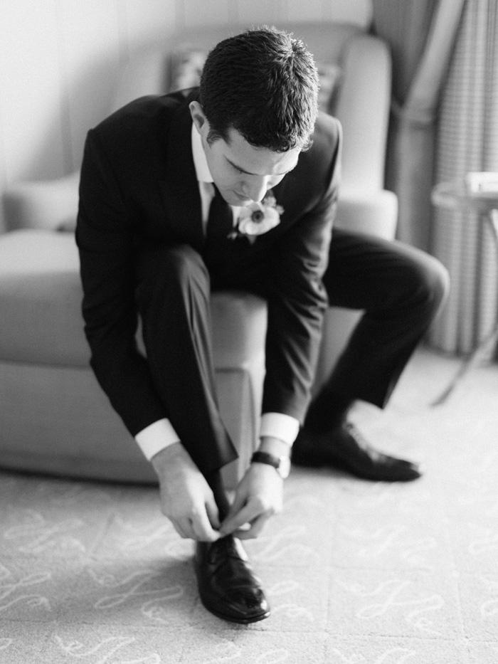 groom tying shoes Ritz-Carlton hotel