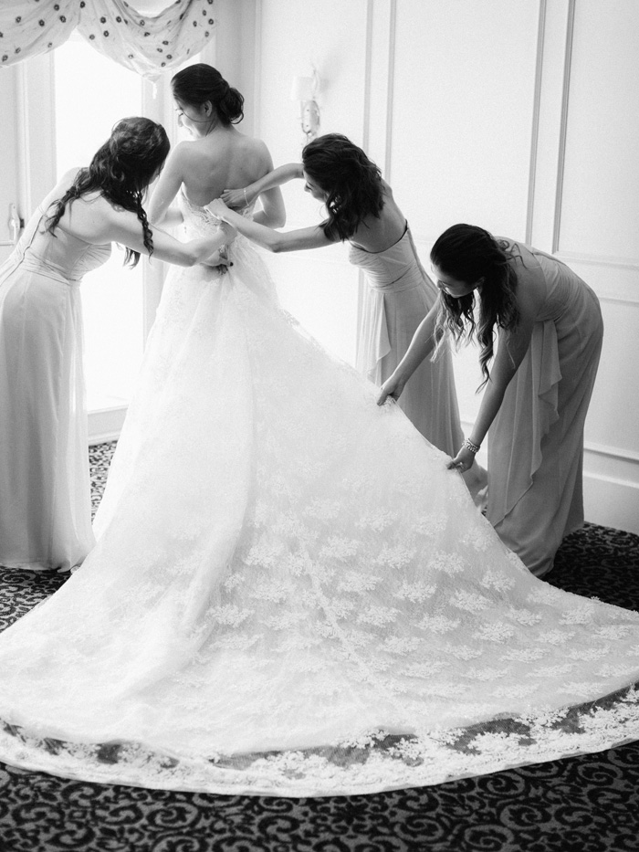 Bride getting dressed at Forest Hills Country Club