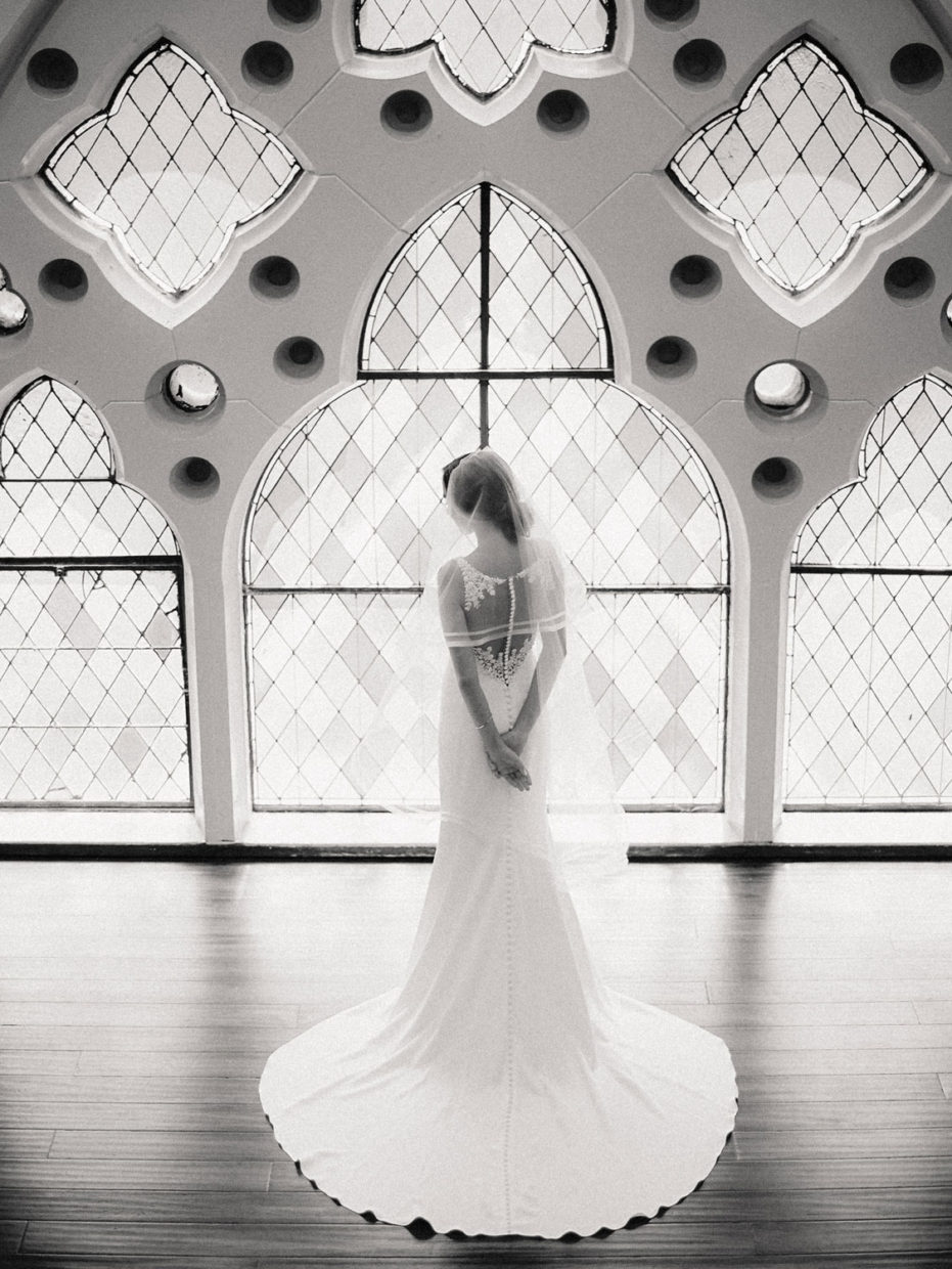 bride in front of stained glass windows