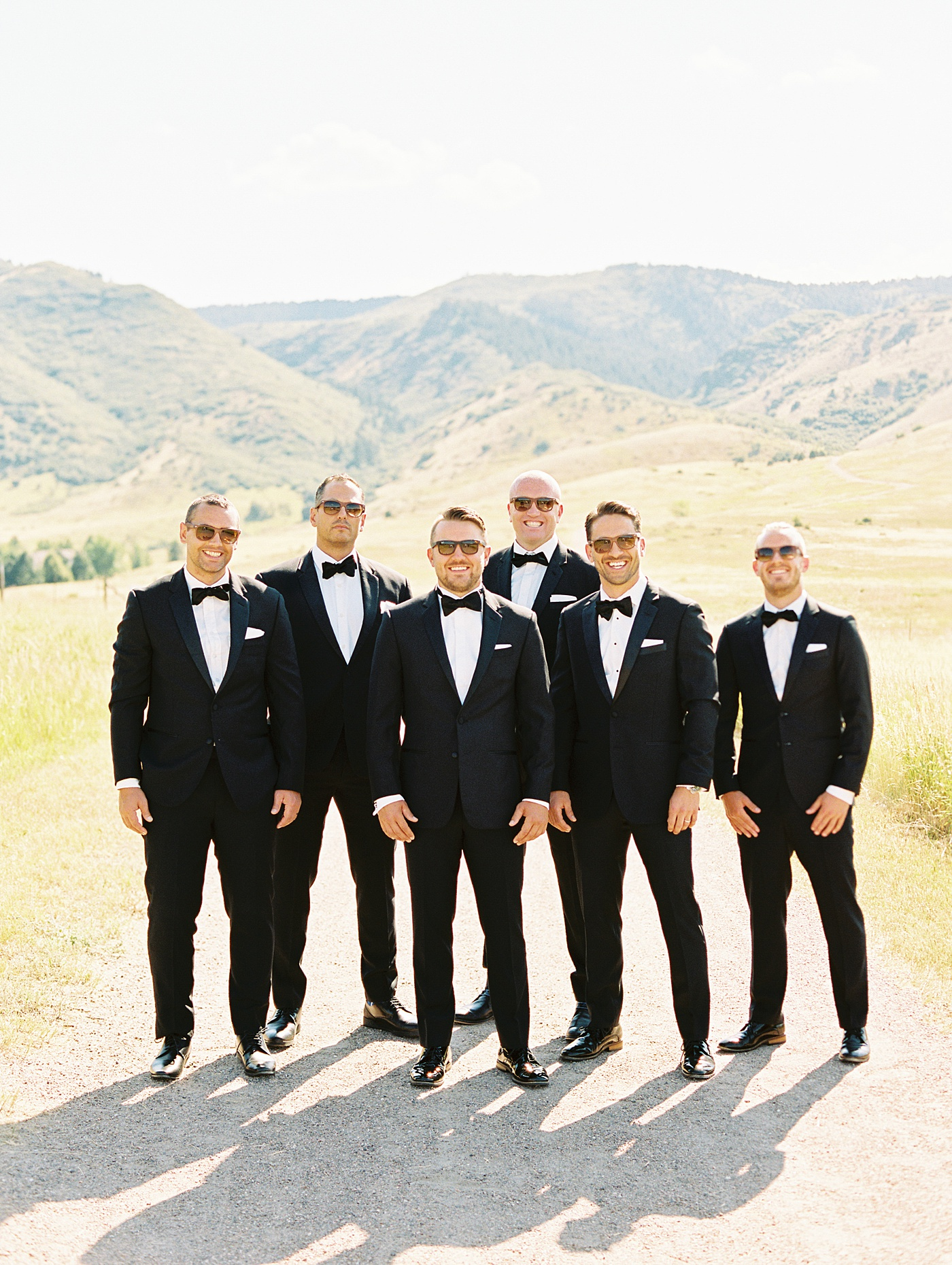 groomsmen in mountains